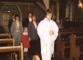 Kristības un iesvētības 09.11.2004., mācītājs Raitis Jākobsons ar kristāmajiem